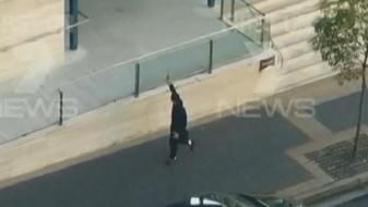 Farhad Jabar and a police officer exchanging fire outside the Parramatta police headquarters