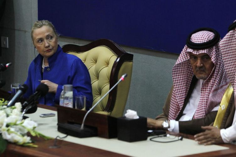 U.S. Secretary of State Hillary Clinton speaks during a joint news conference with Saudi Foreign Minister Prince Saud al-Faisal after a U.S.-Gulf Cooperation Council forum at the GCC secretariat in Riyadh March 31, 2012. The United States will work with Gulf Arab nations to strengthen their shared defenses against threats including Iran, Clinton said on Saturday. REUTERS/Fahad Shadeed (SAUDI ARABIA - Tags: POLITICS)