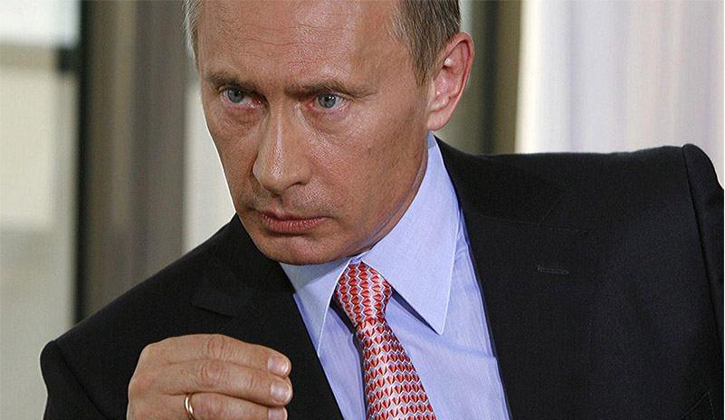 Putinlookingserious