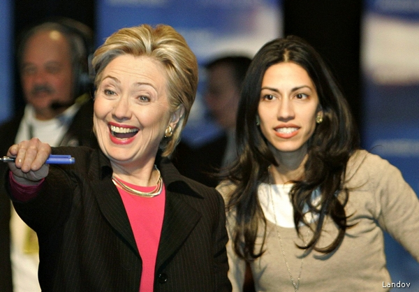 DEMOCRATIC PRESIDENTIAL CANDIDATE US SENATOR HILLARY CLINTON WAVES TO THE CROWD WITH HER PERSONAL ASSISTANT HUMA ABEDIN AT HER SIDE AFTER THE MSNBC/NEVADA DEMOCRATIC PARTY PRESIDENTIAL CANDIDATE'S DEBATE IN LAS VEGAS